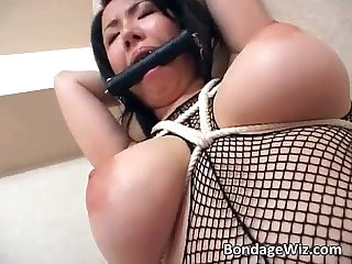 Big tit asian slut is tied while dildo