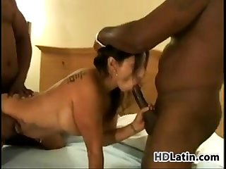 Latina in a threesome with big black dicks