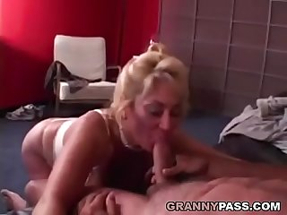 Busty grandma is getting her pussy stuffed