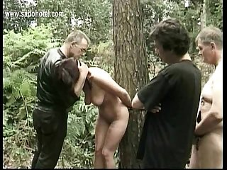Hot and horny slave tied to tree with got played with by two masters while her husband is watching