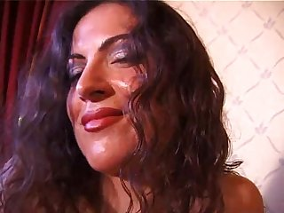 Curly brunette masturbates