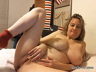Hairy Milf plays around with her pussy