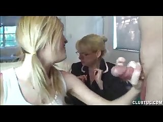 Teen and mature double team handjob