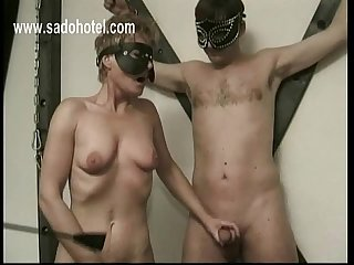 Older slave jerks-off other slave while playing with her own pussy she gets spanked on her ass