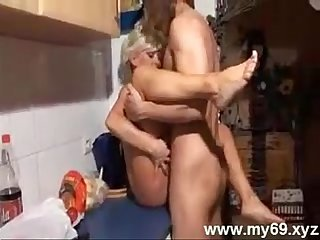 Blonde german mom sucking and fucking boy in the kitchen