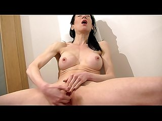 Horny brunette MILF with big tits fingering herself a lot