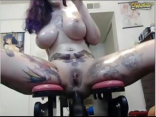 Busty tattooed babe riding a huge dildo in her ass 2