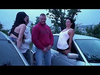 A girl undressing in a car on the way to the public sex gangbang orgy