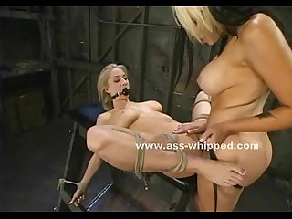 Tied up blonde is flogged and spanked