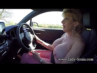 Mature blonde Lady Sonia plays with her tits while driving