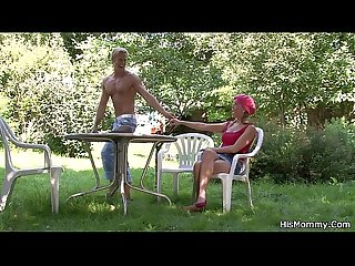 Mom toying his girl outdoors