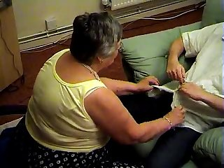 Grandma libby from epikgranny com gives blowjob and footjob
