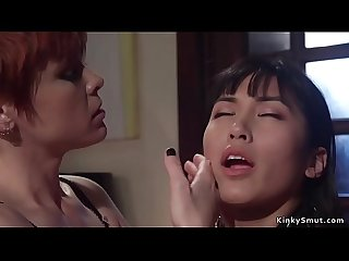 Gagged Asian slave is anal fucked lezdom