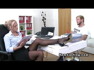 Blonde agent in stockings bangs on sofa