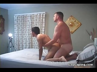 Handsome brunette gays have wild fuck in bedroom
