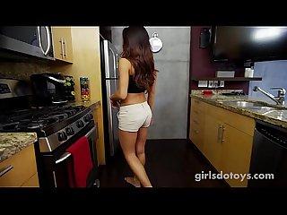 Hot petite tanned teen masturbates in kitchen