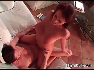 Horny redhead with enormous tits
