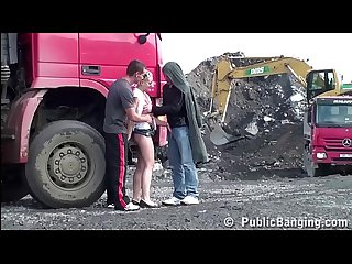 Young blonde cute girl public sex threesome at a construction site