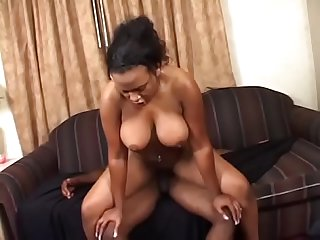 Black chick with fat booty takes on black cock on the sofa