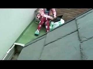 Spying my sister masturbating in terrace