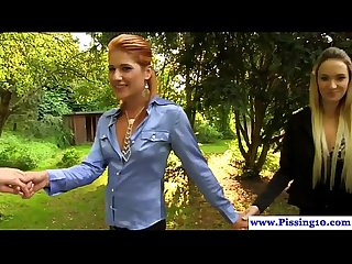 Glam les piss lovers peeing in group outdoors