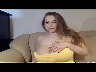 Busty babe playing with her tits