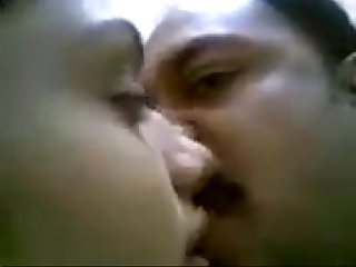 Young indian girl with uncle kissing