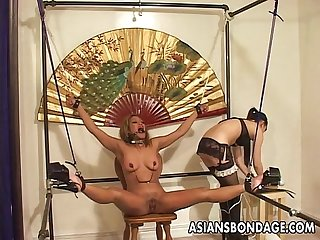 Restrained asian chick tormented by her smoking hot mistress