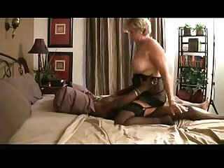 Granny riding black dick on bed