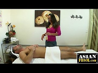 Naughty asian masseuse getting fucked