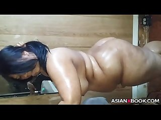 Chubby asian babe inserts bottle