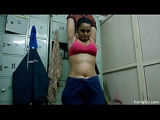Indian girl lily changing dress in gym changing room