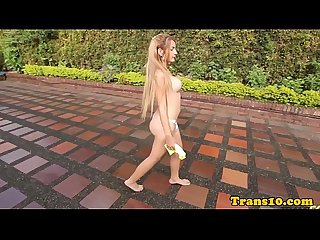 Tgirl with nicetits jerking her cock outdoors