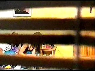 Spy cam peeping at girl through window