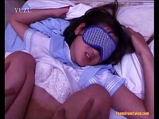 A young asian girl wearing a blindfold is laying on from http alljapanese net
