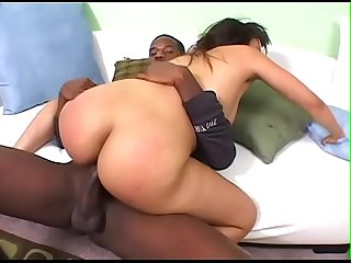 Honey skin babe Angelica Black gets pounded hard by a black stud on the sofa