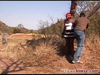 Torturing African slut outdoors tied up big tits