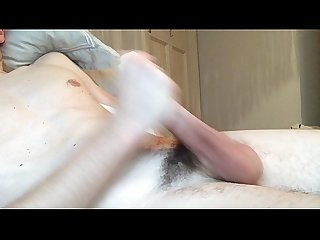 Sexy young muscled twink jerking his big cock until he cums on his hot abs