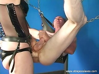 Mature strapon Mistress Kelly fucking her slave