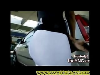Tight ass chick back pumping gas