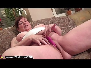 Old busty mom gets big pink dildo which
