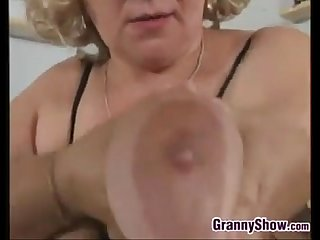 Thick grandma plays with her pussy and tits
