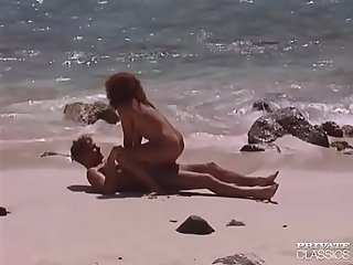 Erika bella busty redheaded fucking in a tropical beach