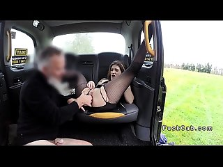 Brunette in fishnets sucking balls in fake taxi