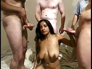 Sexy Indian babe sucks and rides a group of cocks in hardcore gang bang