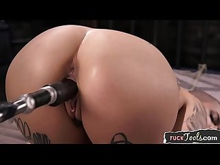 Masturbating beauty fucked by sex machine