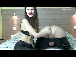 Diva del Tubo giving a painful fisting to a slave