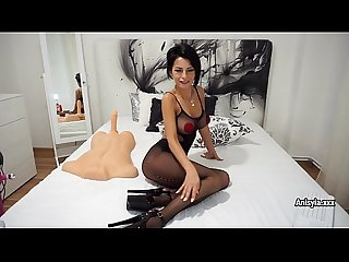 Busty sex-bomb Anisyia in fishnet bodysuit plays with sex-toys